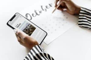Woman scheduling on a calendar